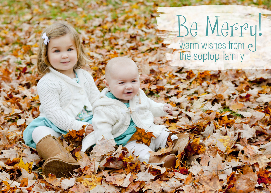 Be Merry! Girls in turquoise sitting in orange leaves. Calm Cradle Photo & Design