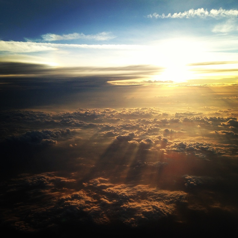 Sunset over the Atlantic from 30,000 feet. Florida from the wing. By Calm Cradle Photo & Design
