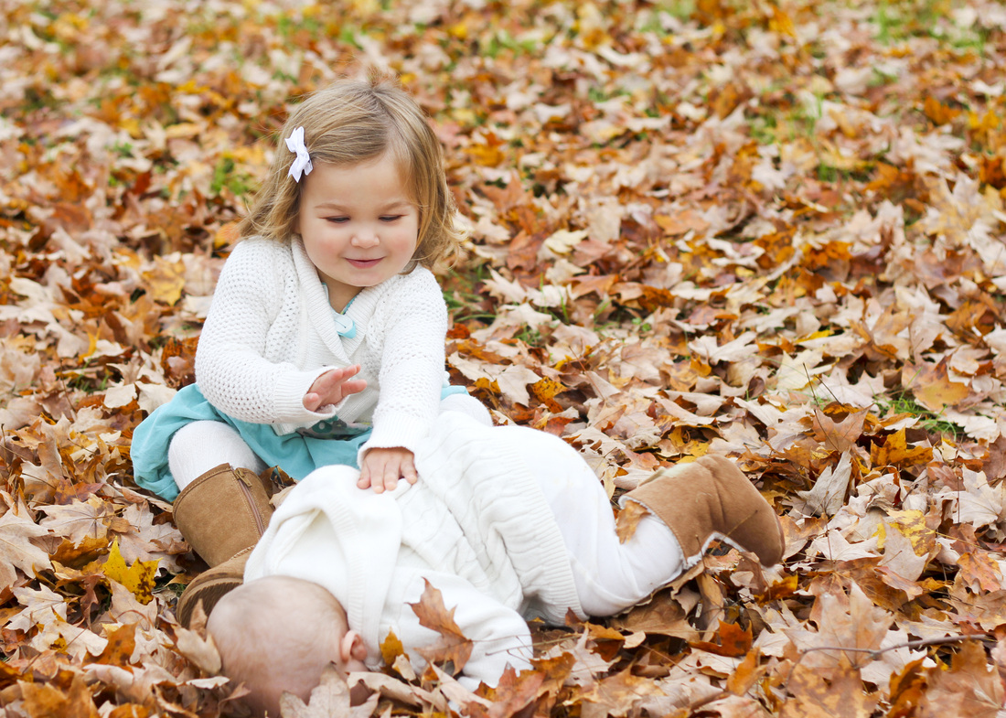 Portraits: Holiday card outtakes. Girls in turquoise sitting in orange leaves. Calm Cradle Photo & Design