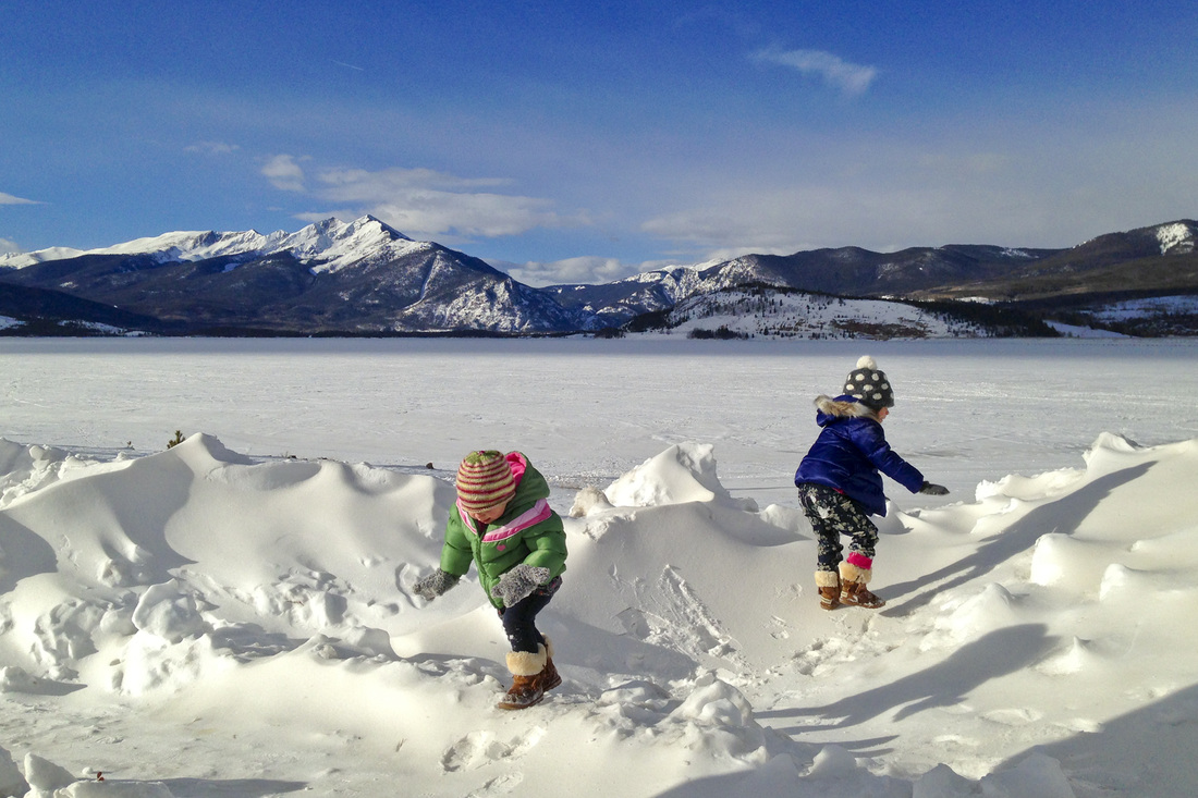 Kids climbing snow drifts in Dillon, Colorado. By Calm Cradle Photo & Design. #lakedillon #summitcounty #colorado #mountains