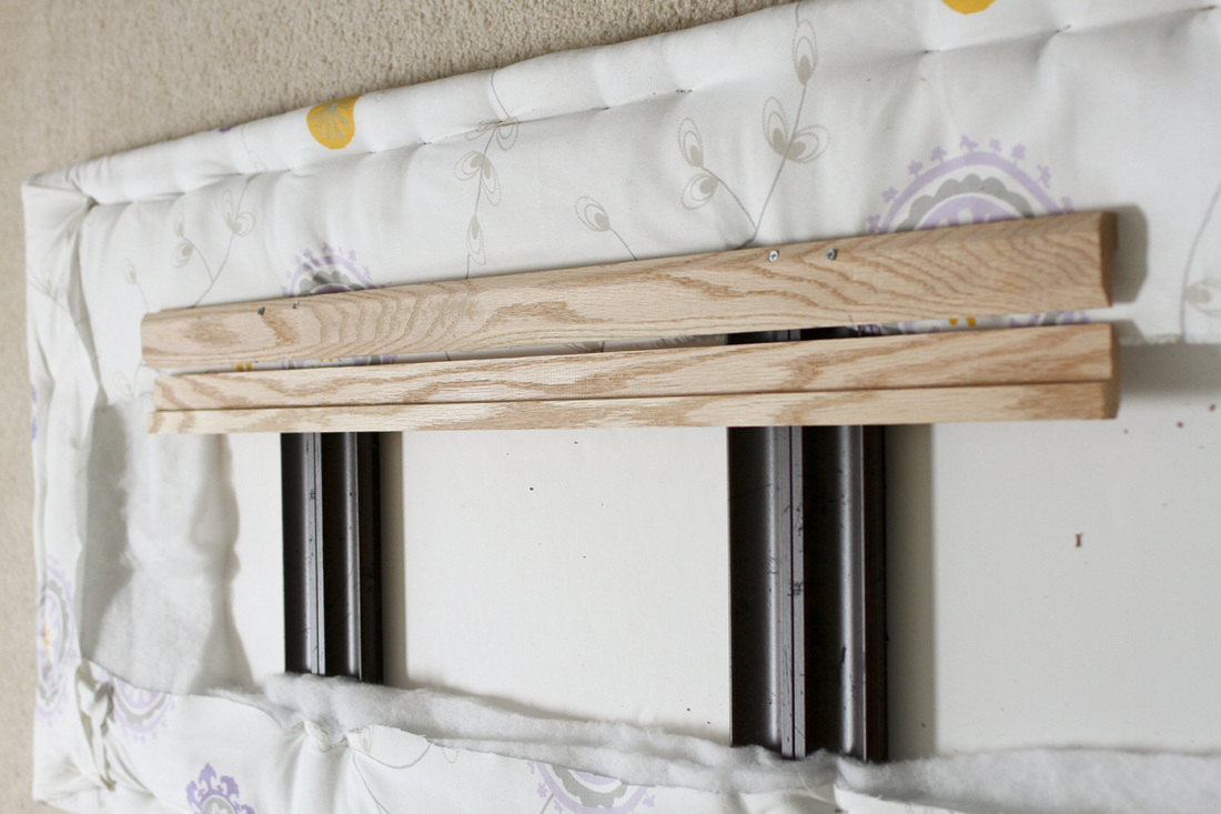 DIY upholstered headboard from upcycled picture frames. Design and photography by Calm Cradle Photo & Design