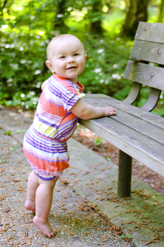 Portraits: 1-year-old standing at a park bench. Calm Cradle Photo & Design