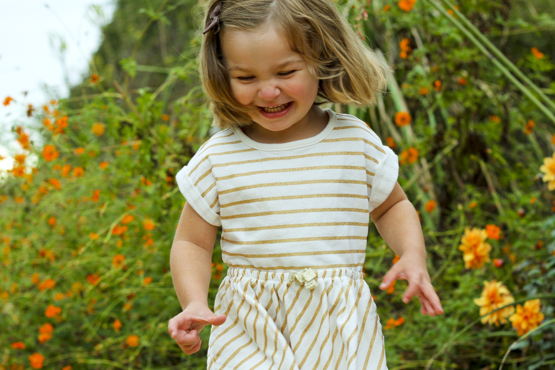 3-year-old portrait. Laughing in the garden. By Calm Cradle Photo & Design