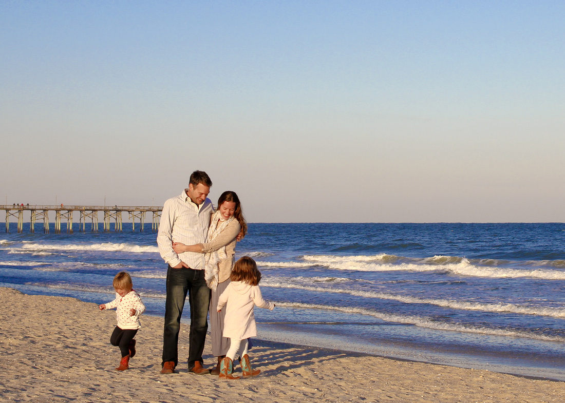 Fall portrait: Family beach photo. Girls running circles around their parents. By Calm Cradle Photo & Design