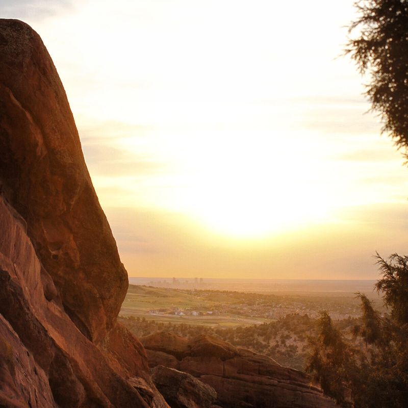 Sunrise over Denver and the Great Plains from Red Rocks Amphitheatre. Denver, Colorado. Photography by Calm Cradle Photo & Design