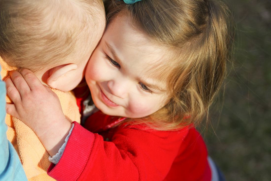 2-year-old portraits. Hugging sibling. Calm Cradle Photo & Design