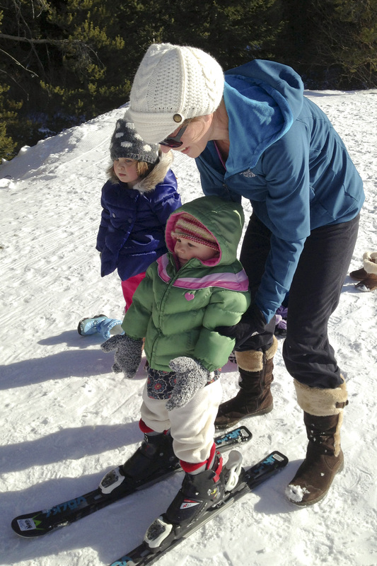 Toddler on skis for the first time.