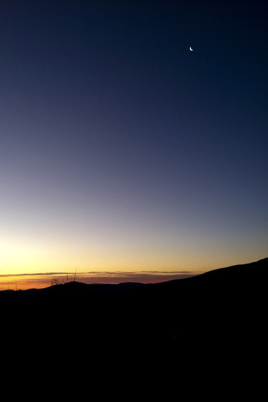 Sunrise over the Blue Ridge Mountains with moon still high in the sky. Calm Cradle Photo & Design