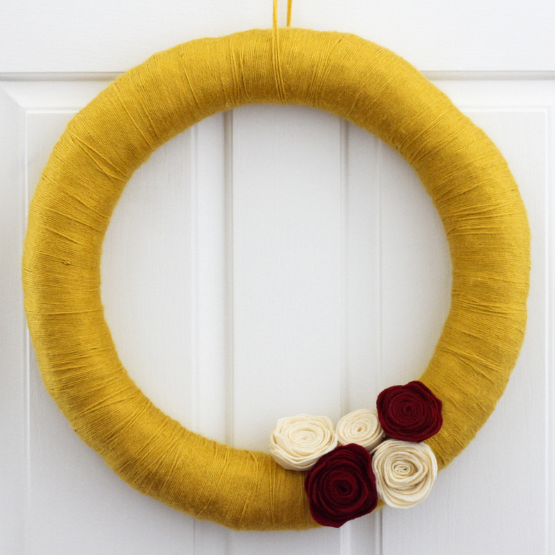 Fall yarn wreath with felt flowers. Calm Cradle Photo & Design