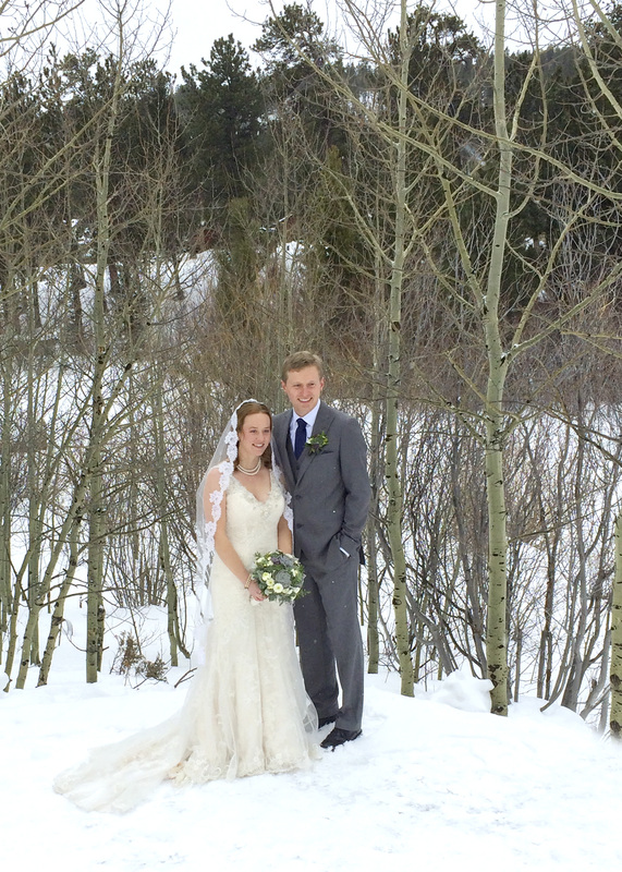 The bride and groom at Wild Basin Lodge in Allenspark, Colorado. By Calm Cradle Photo & Design