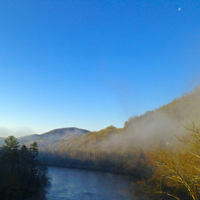 French Broad River flowing through Blue Ridge Mountains with moon still in view. Blue Ridge Parkway, Asheville, NC. Julia Soplop/Calm Cradle Photo & Design