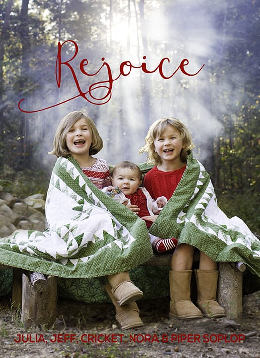 Look at the sun filter through the campfire smoke! Holiday card photos around the fire pit, wrapped in a quilt. Traditional red and green. Photography and graphic design by Calm Cradle Photo & Design. Chapel Hill, NC.